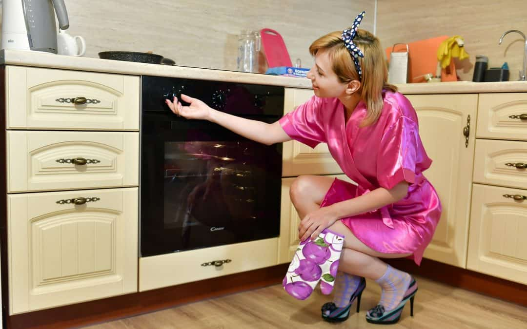 mother checking the oven door if there is a problem