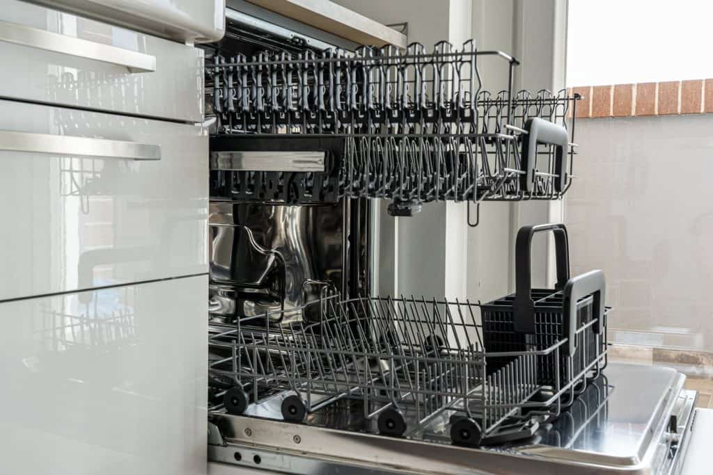 A clean dishwasher without any plates, utensils or glass
