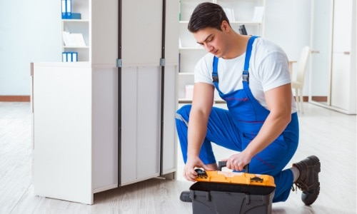 A repairman preparing his tools