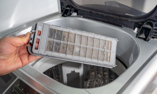 filter of a washer or washing machine that needs to be clean by using your hands
