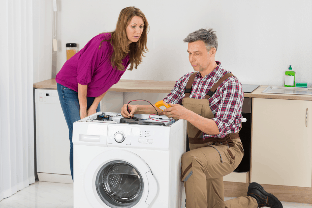 A technician trying to fix the washing machine at home