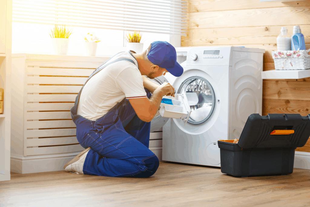 Quality Appliance Repair Technician tinkering the washing machine