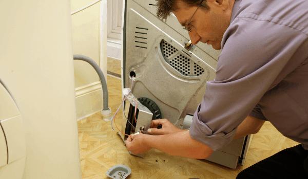 Technician repairing the dryer
