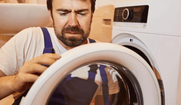 A technician fixing a dryer